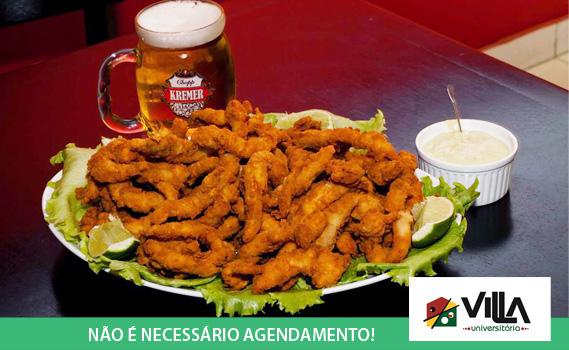 Happy Hour Perfeito!!! 01 Porção de Isca de Tilápia (600g) + Molho Verde no Villa Universitária. Serve bem 03 Pessoas. Compre quantos cupons quiser. Imagem Real